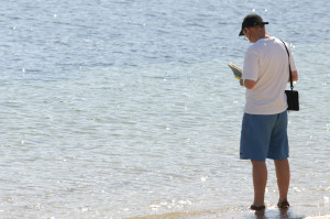 scillyman reading book in water