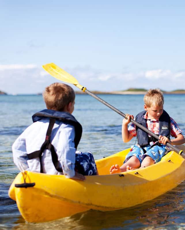 Children kayaking - Tresco, Isles of Scilly