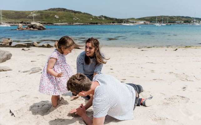 Family on the beach - Bryher, Isles of Scilly