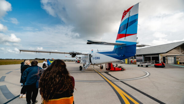 passengers boarding Skybus at Land's End Airport